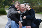 Cartoonist Peter Bromhead with his sons Felix Bromhead, 4, and Oscar Bromhead, 11 at the Parnell Rose Gardens. Photo / Doug Sherring