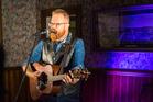 The crowd loved folk singer Adam McGrath when he performed at the Te Runanga Tea Rooms last year. PHOTO/MEAD NORTON