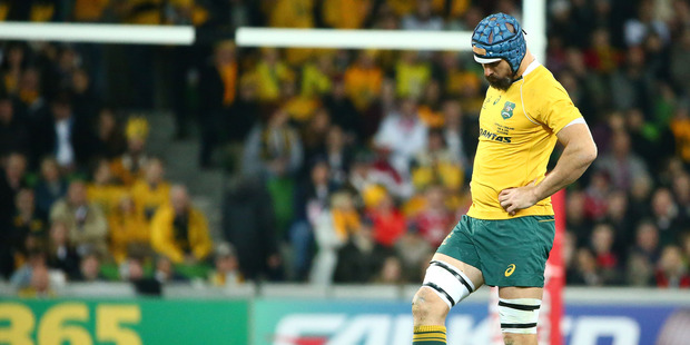 Scott Fardy of the Wallabies kicks the turf after it was ripped up in a scrum in the first half and the players had to move to rehold the scrum. Photo / Getty Images.