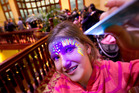 Layla Thompson, 8, used an ultra-violet torch to make her face painting glow. PHOTO/BEN FRASER