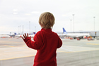 You can say goodbye at  departures but it's not the same as watching your loved ones take off. Photo / Getty Images