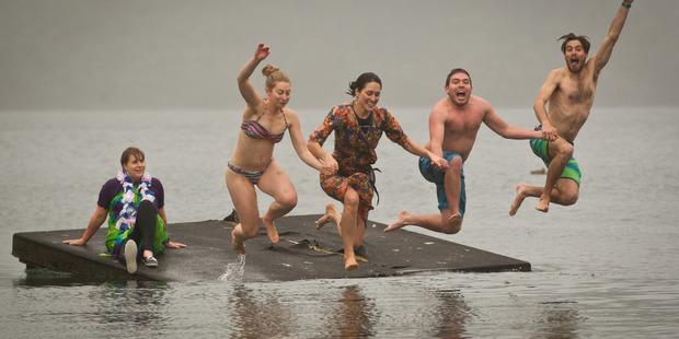 PLUNGE: Pam Asplin (left), Stefanie Lumnitz, Michelle Easton, Mathieu Idrovo, Victor Gager took Scion's annual plunge into cold waters. PHOTO/STEPHEN PARKER