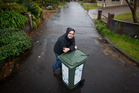 Richard Marshall and some of his neighbours don't want to use the council's proposed new wheelie bin rubbish collection service. Photo / Stephen Parker