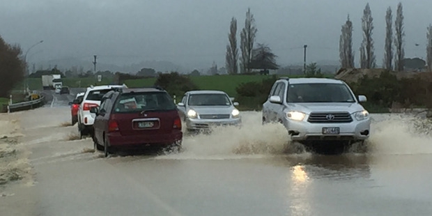 Loading Flooding at Pukehina in Bay of Plenty. Photo / Alan Gibson