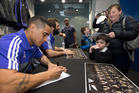 New Zealand All Blacks Aaron Smith and Sam Whitelock during a signing session at Champions of the World store, Dunedin, on Thursday. Photo / Brett Phibbs.