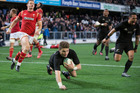 All Blacks first-five Beauden Barrett runs in for his second try. Photo / Brett Phibbs