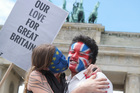 A couple in Berlin join a Kiss Marathon event to support the Remain votes in Britain's referendum. Photo / AP