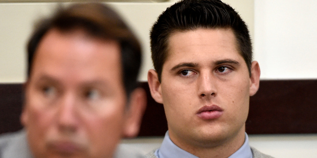 Brandon Vandenburg, right, a former Vanderbilt football player, listens during his retrial. Photo / AP