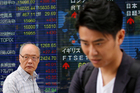 People walk past an electronic stock indicator of a securities firm in Tokyo. Photo / AP