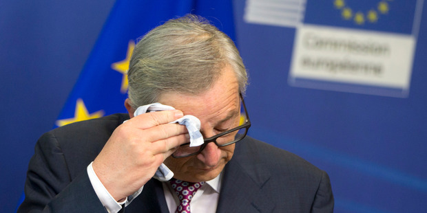 European Commission President Jean-Claude Juncker also appeared to feel the heat. Photo / AP