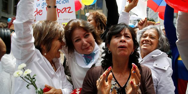 People celebrate the agreement between Revolutionary Armed Forces of Colombia, FARC, and Colombia's government. Photo / AP