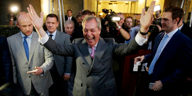 "Loading Nigel Farage, the leader of the UK Independence Party celebrates and poses for photographers as he leaves a ""Leave.EU"" organization party. Photo / AP"