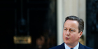 John Key can help pal David Cameron by negotiating a trade deal with Britain. Photo / AP