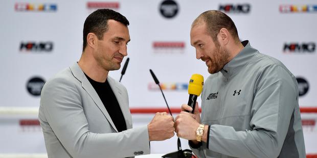 Britain's heavyweight world boxing champion Tyson Fury, right, and Wladimir Klitschko of Ukraine. Photo / File