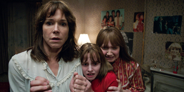 Frances O'Connor, Madison Wolfe and Lauren Esposito in a scene from the cinema thriller The Conjuring 2. Photo / AP
