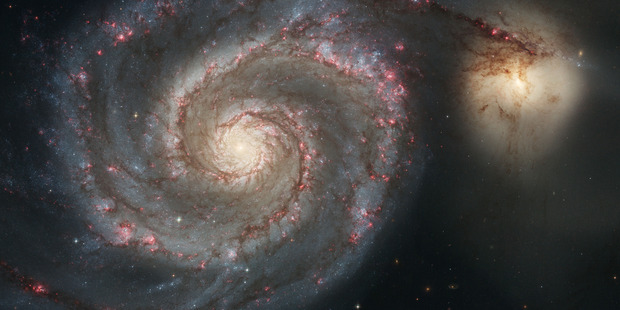 the Whirlpool Galaxy and a companion galaxy. Photo / AP