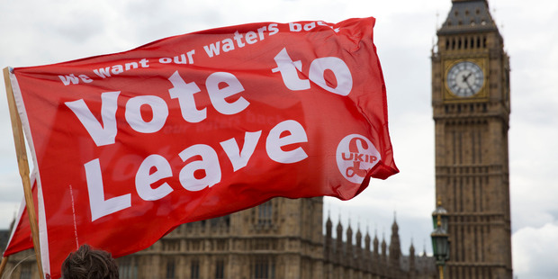 Leave supporters hold flags as they stand on Westminster Bridge during an EU referendum campaign stunt. Photo / AP