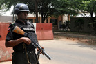 A police officer stand guards in Nigeria. File photo