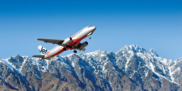 A Jetstar plane takes off out of Queenstown.
