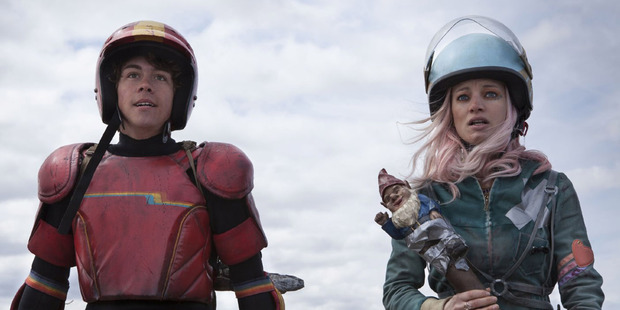 Munro Chambers as The Kid and Laurence Leboeuf as Apple in Turbo Kid. Photo / Supplied