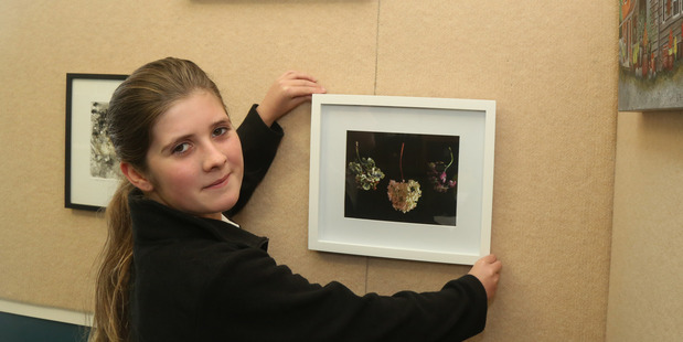 PICTURE PERFECT: Turakina student Isabella Ford, 12, with one of the artworks that were auctioned at the weekend.
