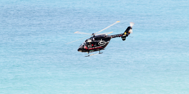 The Lowe Corporation Rescue Helicopter were called to Pourerere beach to search for a missing diver this afternoon. PHOTO/File