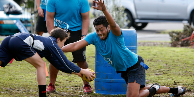 Northland Taniwha player Tumama Tuulua reaches to protect the centre field.
