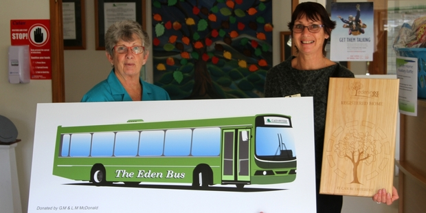 ALL ABOARD: Nurse manager Jenny Kitchen (left) and Lyn MacDonald (reception), with the bus Lyn and husband Mark commissioned as a symbol of Switzer Residential Care's Eden Alternative journey.