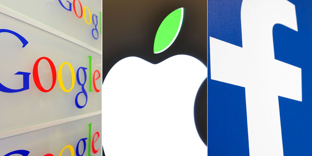 Loading Spark chief executive Simon Moutter has called on tech giants Google, Apple and Facebook to start paying their fair share of tax in New Zealand. Photo / Dean Purcell