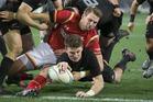 All Blacks first-five Beauden Barrett scores against Wales. Photo / Brett Phibbs