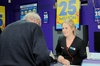 GOOD LUCK: Unichem Stortford Lodge Pharmacy retail manager Jess Gudsell serves another hopeful customer for tonight's big draw. PHOTO/ PAUL TAYLOR
