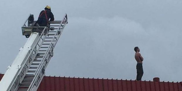 The man climbed on to the roof of Gerry's Charcoal Chicken and Cooked Seafoods. Photo: Nick Hape / Facebook
