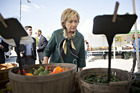 Hillary Clinton views a selection of peppers at a farmers market in Davenport, Iowa, last October. Photo / Daniel Acker, Bloomberg