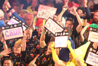 Fans get into the atmosphere as Gary Anderson throws 180 at the Auckland Darts Masters at Trusts Arena. Photo / Chris Loufte.