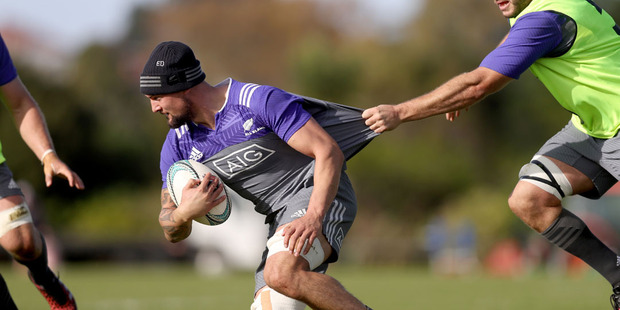 Loading Elliot Dixon of the All Blacks is held back by Luke Romano during an All Blacks training session. Photo / Getty