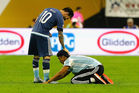 Lionel Messi interacts with a fan who ran onto the field prior to the start of the second half. Photo / Getty Images
