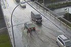 Surface flooding on the Bond St overbridge in Auckland early this afternoon. Photo / Auckland Transport twitter.