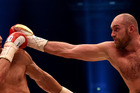 World heavyweight boxing champion Wladimir Klitschko (L) of Ukraine defends against Britain's Tyson Fury during their WBA, IBF, WBO and IBO title bout on November 28, 2015. Photo / Getty