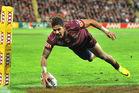 Queensland's Dane Gagai scoring one of his three tries in Origin II. Photo / Getty Images