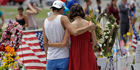 A couple spend a quiet moment at a makeshift memorial honouring the victims of the Pulse nightclub mass shooting in Orlando. Photo / AP