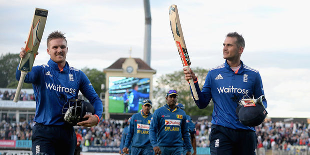 Alex Hales and Jason Roy of England salute the crowd as they leave field. Photo / Getty Images