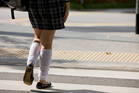 A female student on the way to school. Students told about the short skirt issue became emotional.