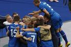 Iceland players celebrate Arnor Ingvi Traustason's winning goal. photo / AP