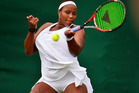Taylor Townsend in action against Olga Savchuk of Ukraine during the 2016 Wimbledon Qualifying Session. photo / Getty