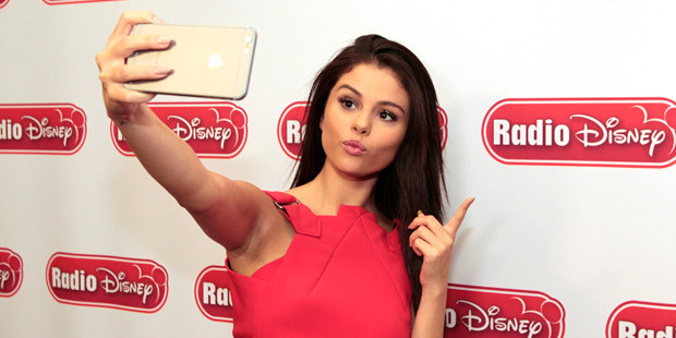 Step away from your phone, Selena Gomez, those selfies may be doing you more harm than good. Photo / Getty