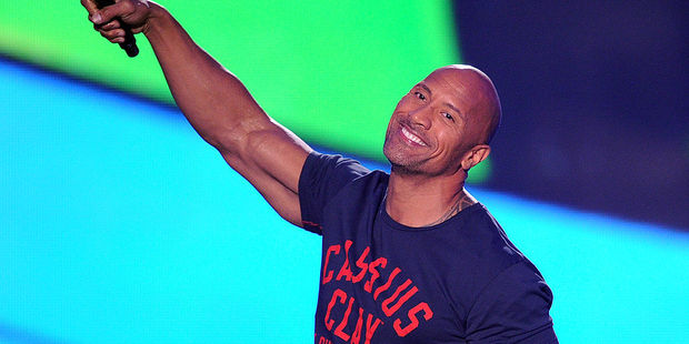 Actor Dwayne Johnson speaks onstage during Nickelodeon Kids' Choice Sports Awards 2014. Photo / Getty Images
