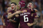 Matt Gillett, Johnathan Thurston and Corey Parker of the Maroons celebrate victory during game two of the State Of Origin series. Photo / Getty