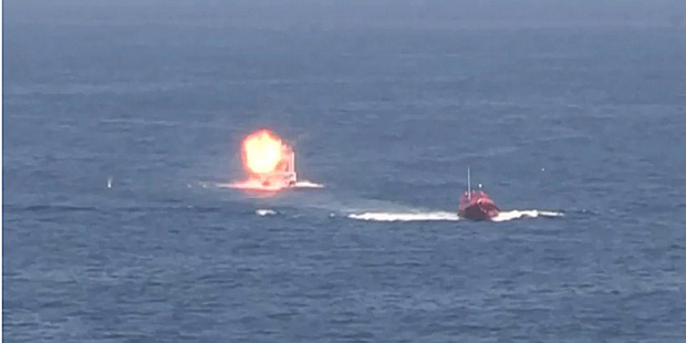 A small boat approaching the USS Ponce explodes during testing of the Office of Naval Research-funded Laser Weapons System (LaWS) while in the Persian Gulf.
