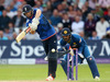 England's Chris Woakes hits out against Sri Lanka, on his way to make his half century. photo / AP