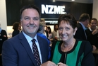 Michael Boggs and NZME director Carol Campbell 'ring the bell' as NZME lists on the NZX yesterday. Photo / Greg Bowker